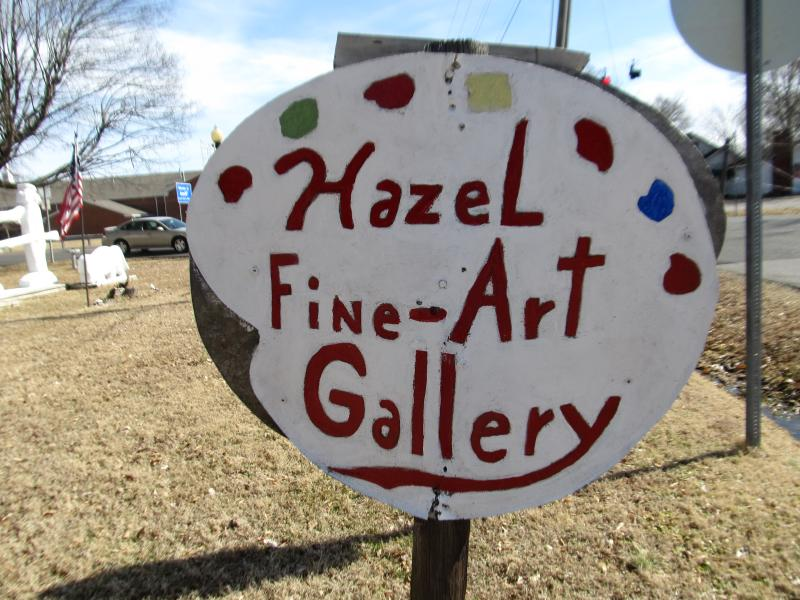 This sign sits outside Glenn Earl Newman's gallery, welcoming all visitors.