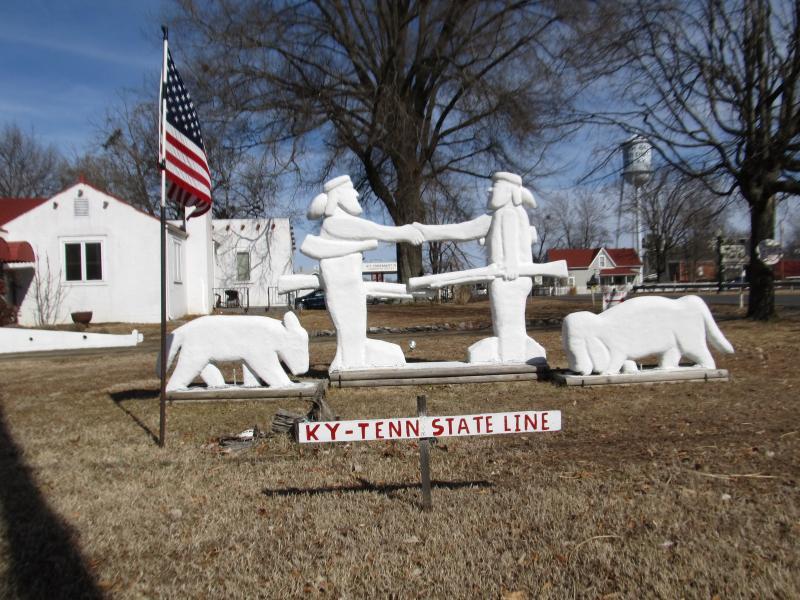 The David Crockett and Daniel Boone statue sits outside Glenn Earl Newman's home and gallery.