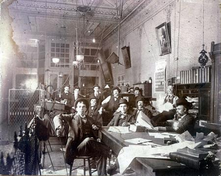 Cobb (sitting at front with poker) at the Paducah News, late 1890s.