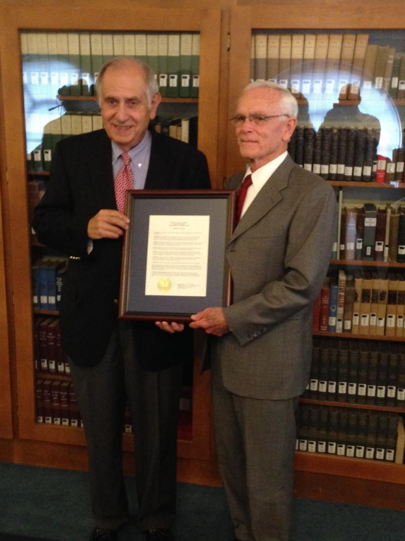 President Tim Miller receives honor for service to MSU from Chair Curris.