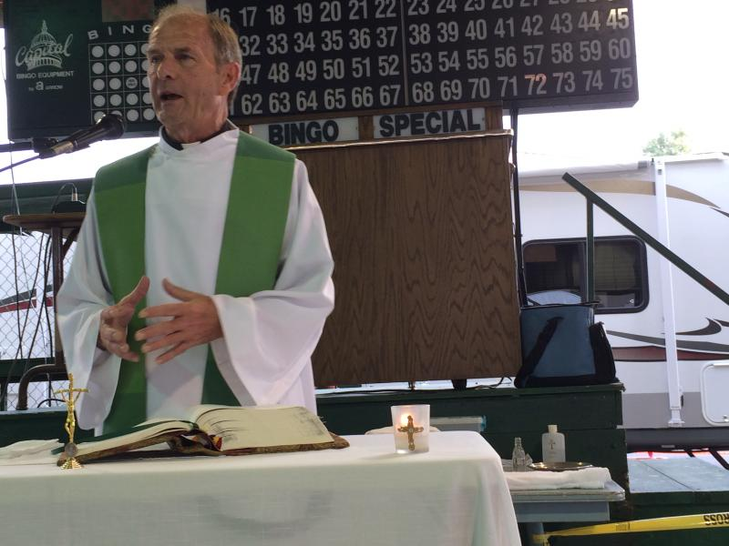 Fr. Darrell Venters conducts mass Friday at Fancy Farm.