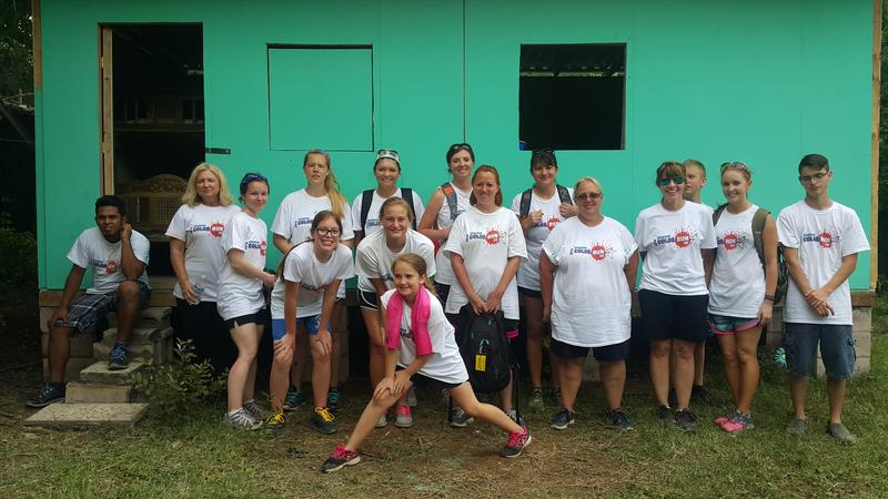 A team of volunteers from Starfish Orphan Ministry and Sus Hijos stands in from of a home it built for a family living near San Salvador, El Salvador.