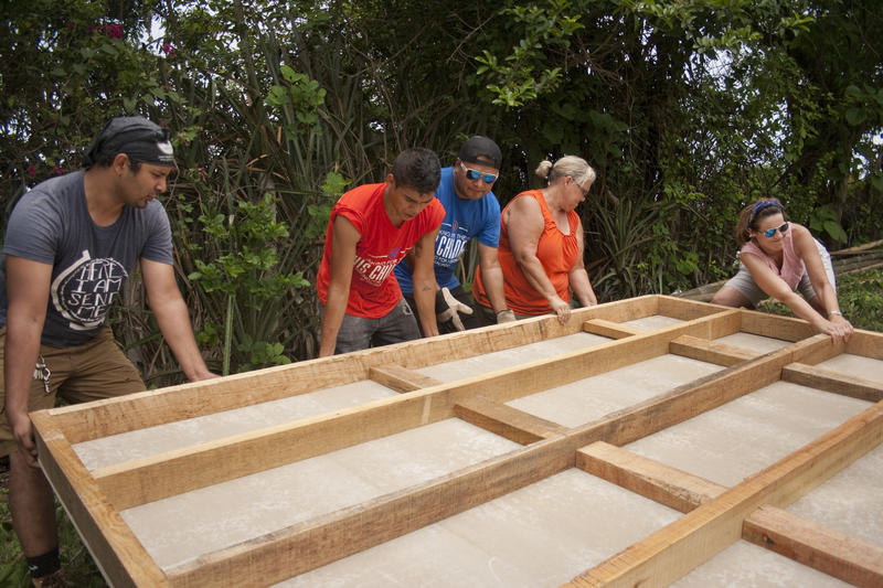 Volunteers are working with partner organization Sus Hijos to construct a house for a poor mother. The woman needed to improve her family's living situation before the government would return custody of one of her sons.