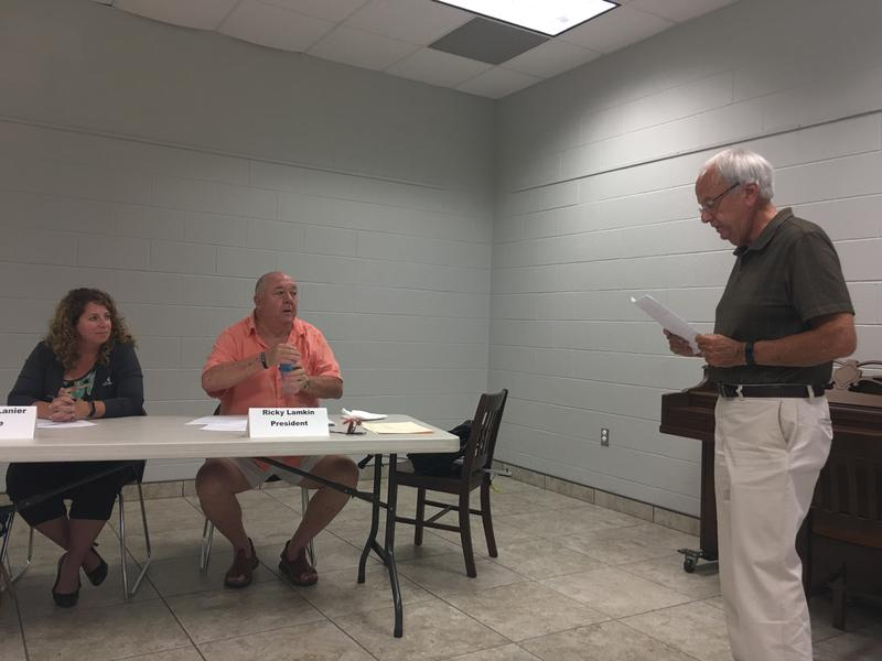 Calloway County Judge Executive Larry Elkins reads an open records request, dated July 19, to the Calloway County Library Board