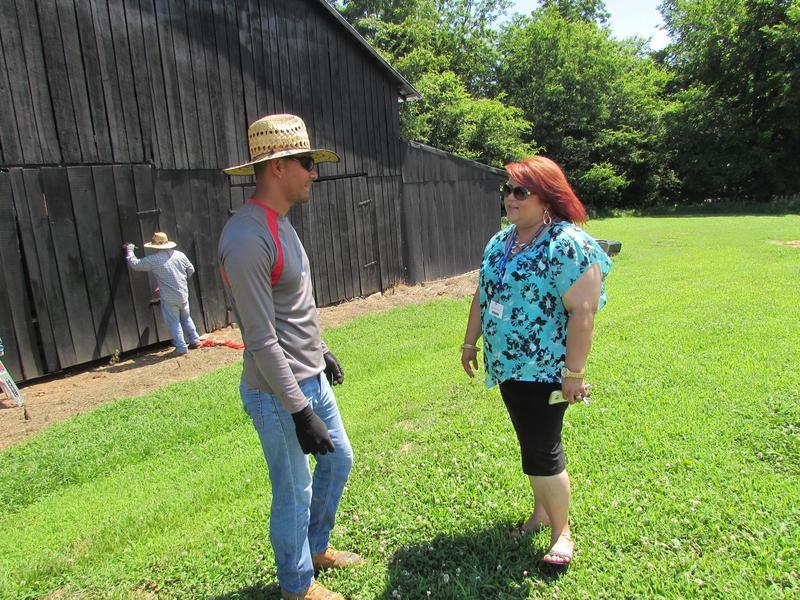 Jonathan Aldana Sanchez with interpreter Mayra Duncan at the Holliday farm.
