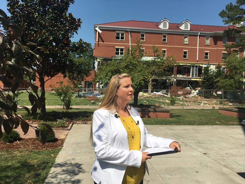 Murray State VP of University Advancement Dr. Adrienne King briefs reporters outside of Hester near the damaged Richmond College.
