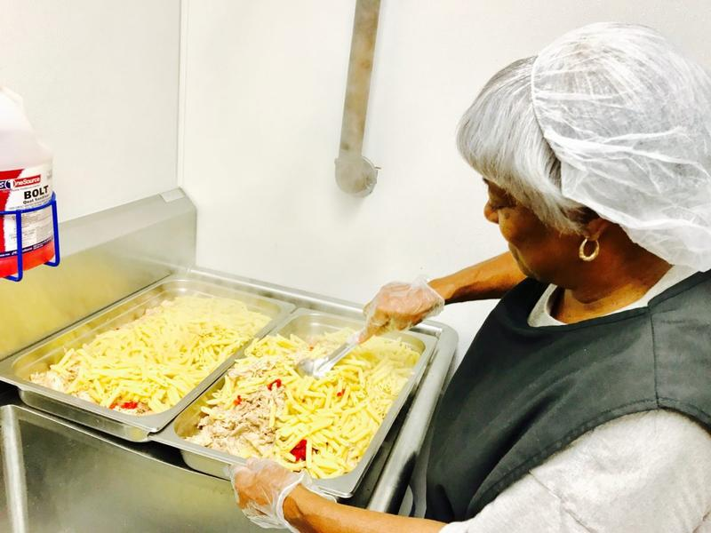 A cook preparing a dish at the Pennyroyal Veterans Center.