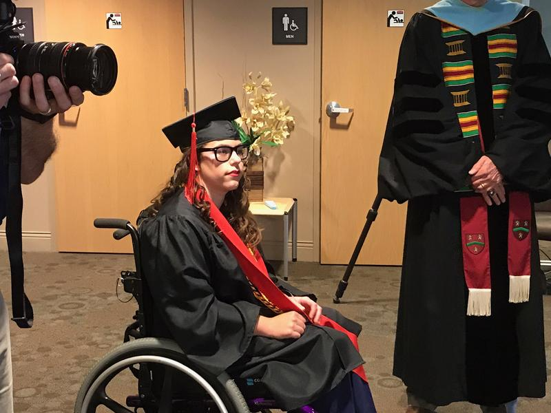 Darlene Raye Jackson receives her diploma at a special graduation ceremony.
