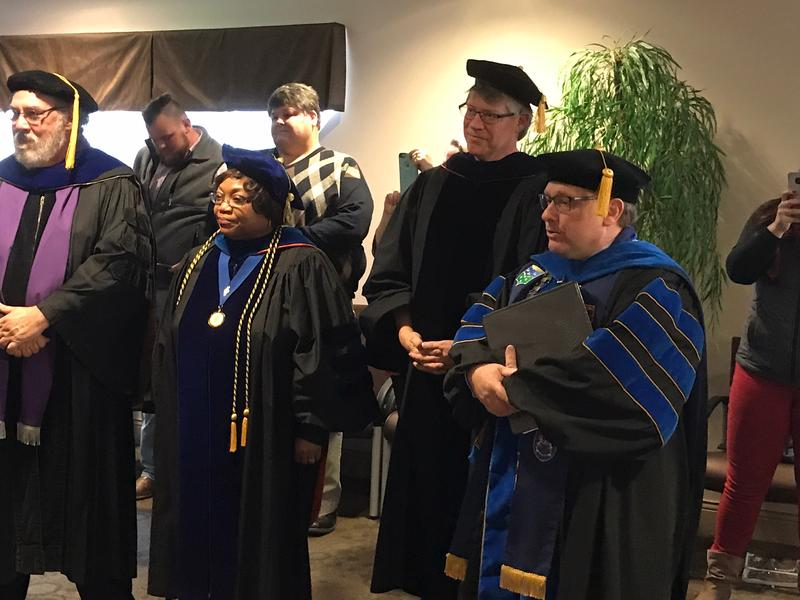 Dr. Davies and the stage party attending the special graduation ceremony.