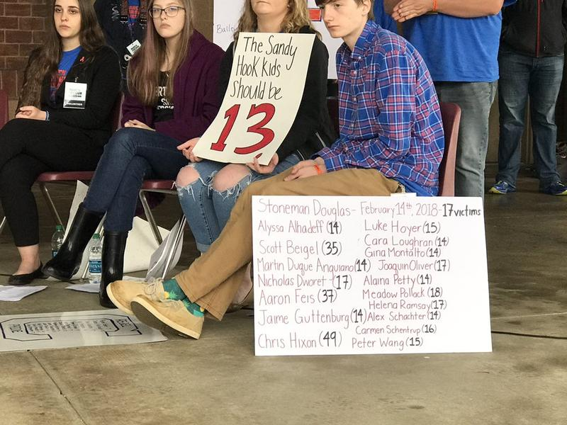A sign shows the names of the victims in the Marjory Stoneman Douglas shooting.