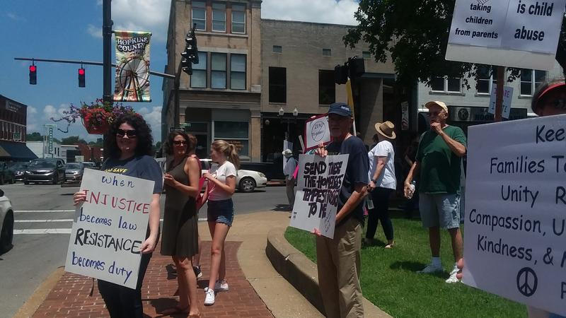 Demonstrators gathered Saturday at the Courthouse Square in Madisonville, Ky.