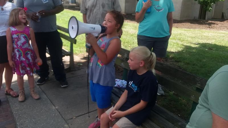 Children gathered with adults Saturday in Madisonville, Ky. to protest the Trump Administration's immigration policies.