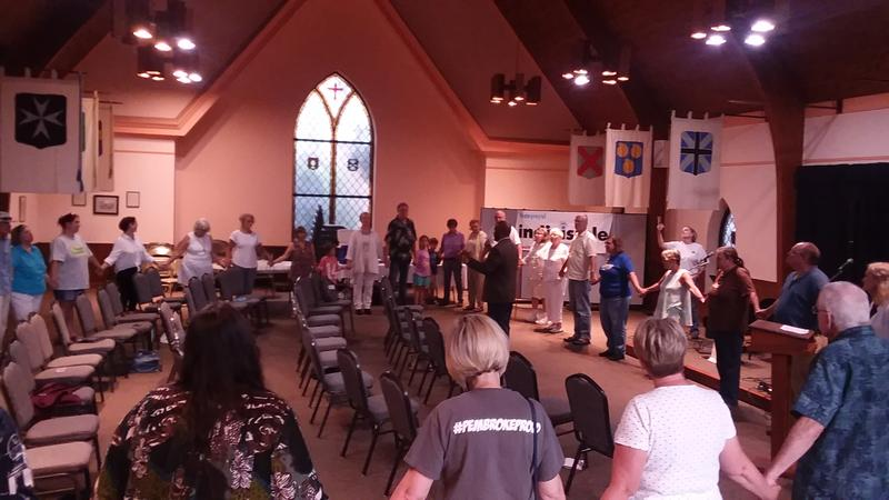 Attendees at the 'Families Belong Together' event in Hopkinsville, Ky. held hands in a circle.