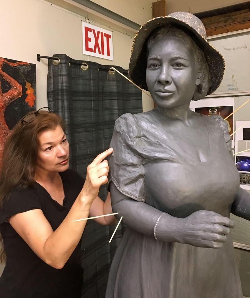 Sculptor Amanda Matthews works on the statue of journalist Alice Dunnigan in her studio in Lexington, Kentucky.