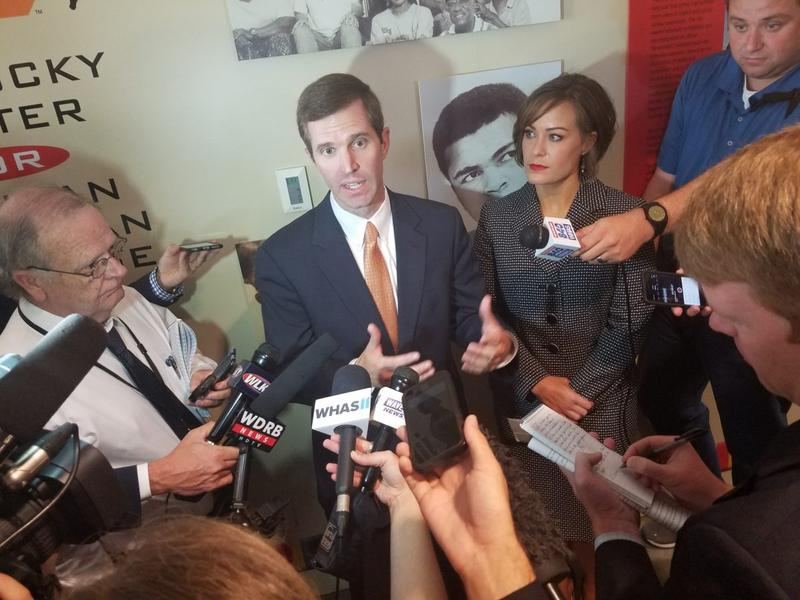 Attorney General Andy Beshear speaking with reporters after announcing bid for governor in Louisville, Ky.