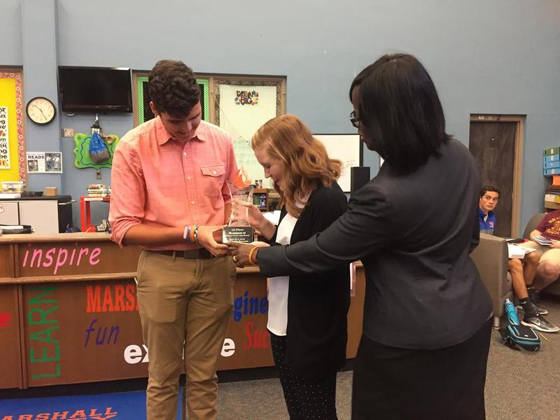 The 'Bluegrass VR' team, comprised of Daniel Sills and Claire Harmon, recieve the first place trophy from Lt. Gov. Jenean Hampton.