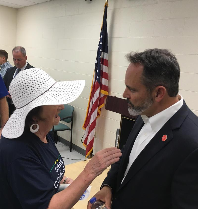 Gov. Matt Bevin speaks with a forum participant following the forum.