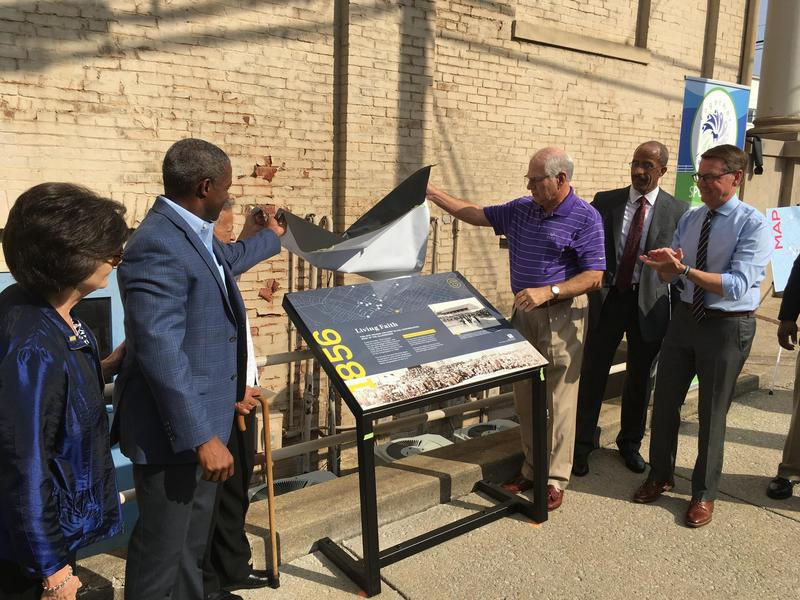 The first of 12 intepretive signs detailing parts of the African American experience in Lexington, Ky., was unveiled Thursday.