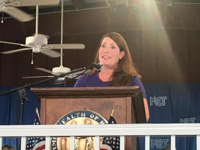 An ethics panel issued an advisory opinion saying that Kentucky Secretary of State Alison Lundergan Grimes can't run for statewide office and serve as the chair of the bipartisan board that oversees elections.