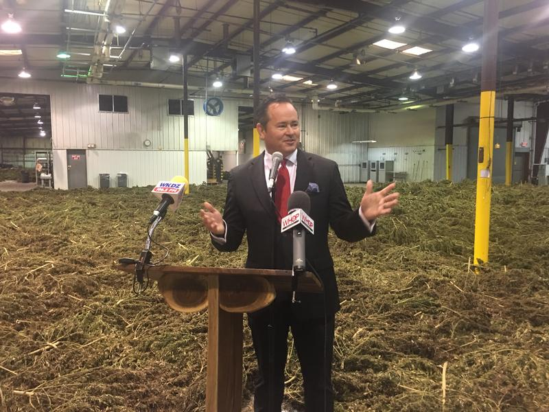 Vertical President Smoke Wallin stands in front of 300,000 pounds of harvested hemp in the company's new facility in Trigg County, Ky.