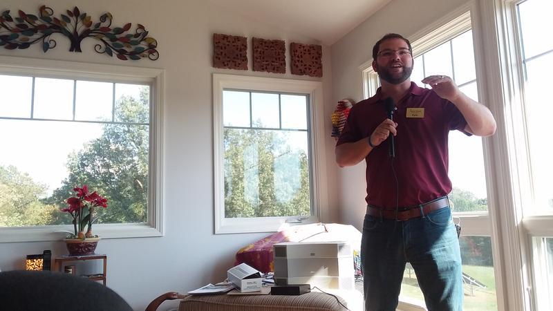 Kyle Johnson of Harvest Energy Solutions speaks at the solar open house.