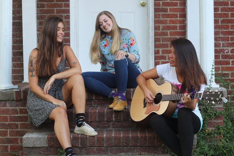 The Black Eyed Susans is composed of Melanie Davis, Kayla Little, and Stephanie Ray (left to right).