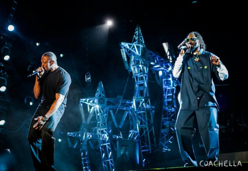Fellow rappers Dr. Dre (left) and Snoop Dogg (right) perform at Coachella alongside a hologram of the late Tupac Shakur.