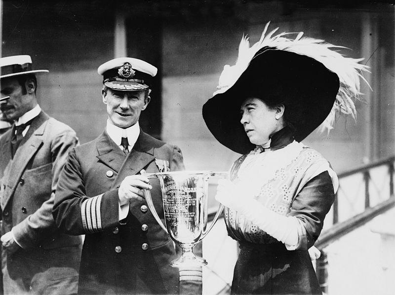 Molly Brown awarding Capt. Arthur Henry Rostron a trophy for his service.