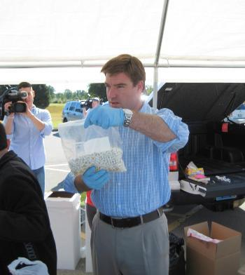Attorney General Jack Conway at a prescription drug Take-Back day in Louisville