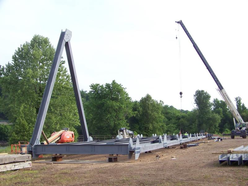 Workers assemble the Eggners Ferry replacement span.