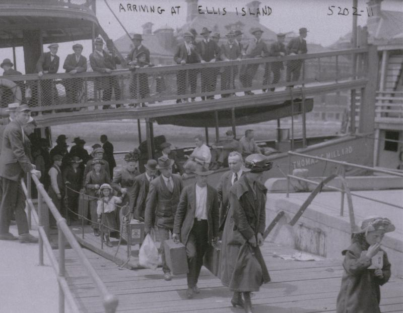 Immigrants arrive by ferry at Ellis Island, around 1900.