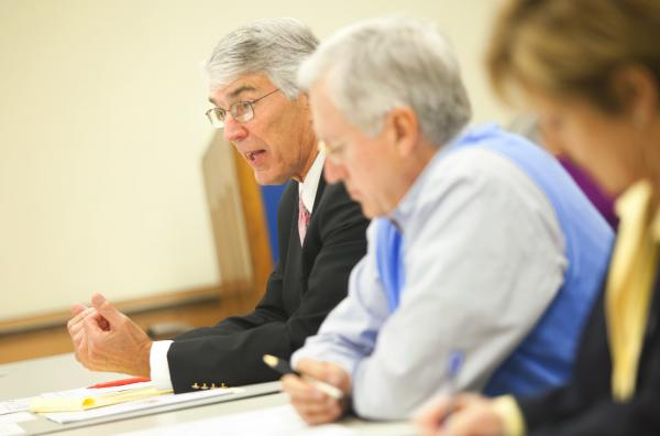 Paducah Riverfront Development Authority member Joe Frampton, left, discusses the future of the project during Wednesday.