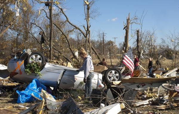 Residents sift through tornado debris on Monday.