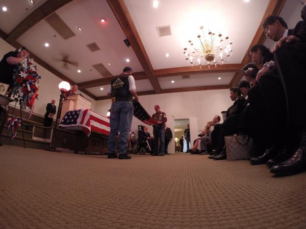 The Patriot Guard conducts a flag folding ceremony. The flag was presented to the Carneal family.