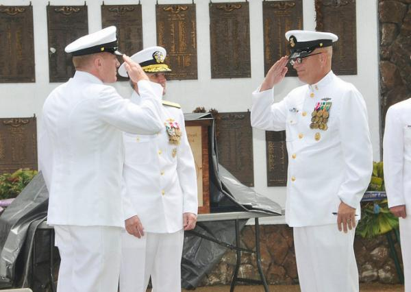 Force Master Chief Russell Mason (left) relieves Force Master Chief Cash Caldwell as the senior enlisted as the senior enlisted advisor to Commander, Submarine Force, U.S. Pacific Fleet, at a June 6 retirement ceremony for Caldwell at Joint Base Pearl Harbor-Hickam.