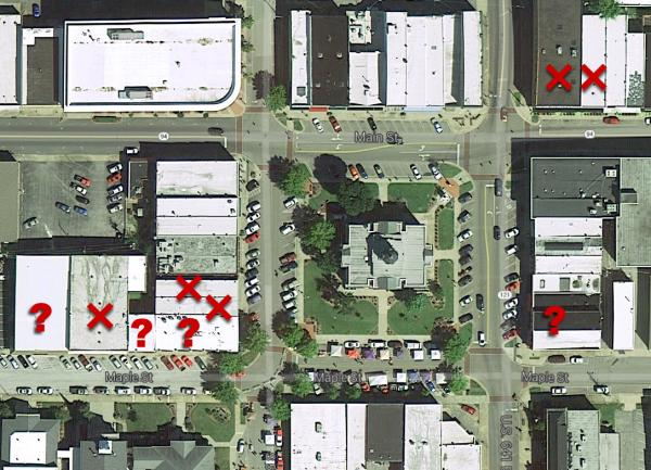 This aerial map includes X's over buildings that have been razed or likely to be razed on Murray's Court Square. The question mark indicates buildings with uncertain futures.  The Calloway County Courthouse sits in the center of the photo.