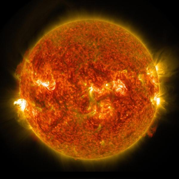 A bright solar flare can be seen on the left side of the sun in this image captured by NASA's Solar Dynamics Observatory on Aug. 24, 2014.