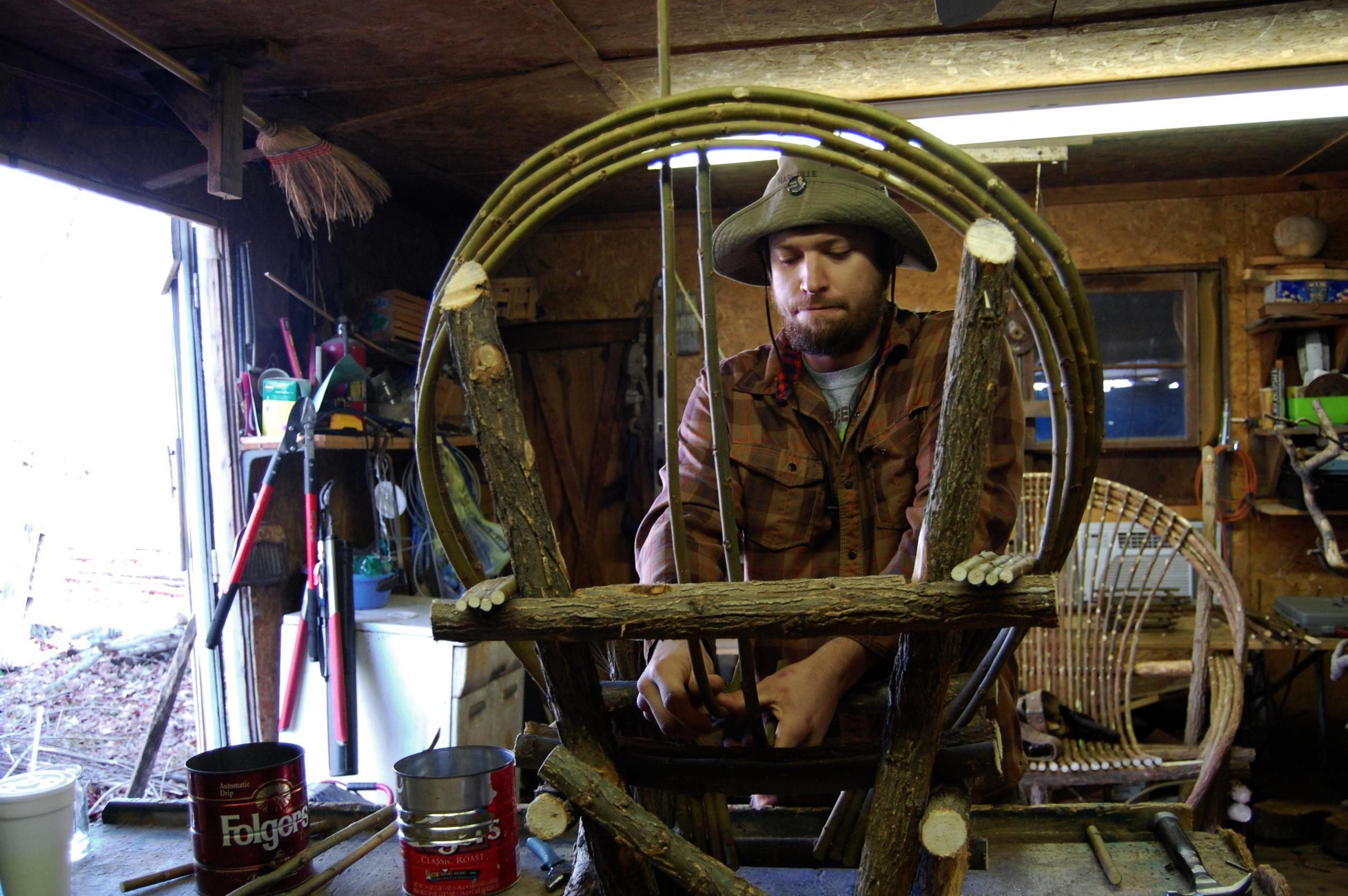 Justin Roberts Works On A Willow Chair.