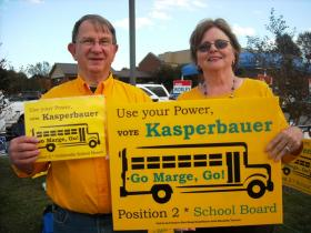 Collierville school board Position 2 candidate Margaret Kasperbauer and her husband hold a sign outside the Collierville Church of Christ early voting location. Kasperbauer is one of five candidates in the Position 2 race.