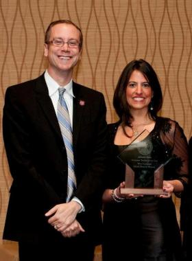 Tennessee Teacher of the Year Allyson Chick holds her award and stands next to Tennessee Education Commissioner Kevin Huffman.