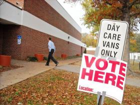 A voter enters Farmington Elementary School.