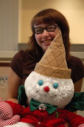 Kerry Crawford from her I <3 Memphis Blog with a Mr. Bingle plush toy.
