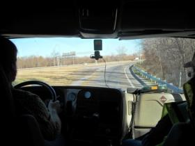 Student David Day (L) pulls onto Interstate 40 under the watchful eye of his Swift Driving Academy instructor Jimmy Seaton (R). Both men are veterans.