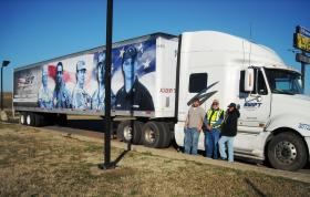 David Day (L), Jimmy Seaton (C), and civilian student Marilyn Smith (R) take a break at a truck stop in Arkansas.
