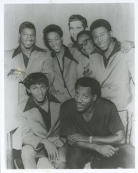 The Bar-Kays with Otis Redding. Top row (Left to Right): Ben Cauley, Carl Cunningham, Ronnie Caldwell, Jimmy King and James Alexander. Bottom row (Left to Right): Phalon Jones and Otis Redding.