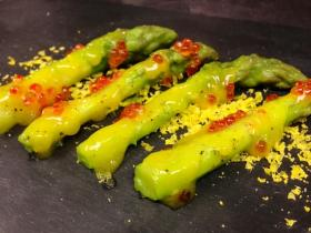 For an amuse-bouche at the March No-Menu Monday, diners ate asparagus with egg, horseradish and trout roe.