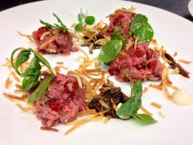 The third course featured Newman Farms lamb tartare with lemon ash oil, sun-dried tomatoes and pea tendrils.