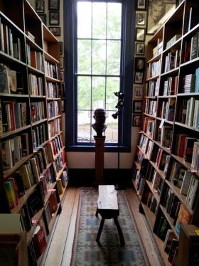 Books line the shelves upstairs at Square Books inviting visitors to linger.