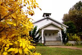 This small church is popular for weddings in Green Frog Village.