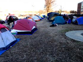 Memphis, Jan. 22, 2014 -- Within 12 hours of one person starting a line outside Shelby County Schools, parents began pitching tents to get students into optional programs, expecting a five-day wait. Due to cold temperatures, school officials honored a sign-up sheet and that allowed campers to go home.